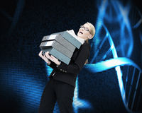 Businesswoman carrying folders Royalty Free Stock Photo