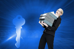 Businesswoman carrying folders Royalty Free Stock Photos