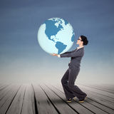 Businesswoman carrying a globe outdoor Stock Photos