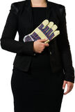 Businesswoman carrying gloves. Businesswoman ready to put on some gloves to do the dirty work royalty free stock photos