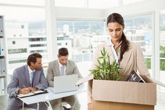 Businesswoman carrying her belongings in box stock image