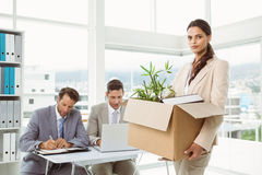 Businesswoman carrying her belongings in box Stock Images