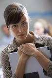 Businesswoman carrying laptop, close-up, front view, portrait, focus on foreground Royalty Free Stock Photography