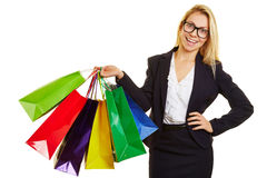 Businesswoman carrying many shopping bags Royalty Free Stock Images