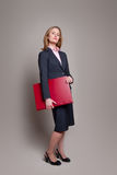 Businesswoman carrying portfolio Stock Photography