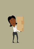 Businesswoman carrying a stack of boxes Stock Image