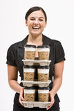 Businesswoman carrying stack of coffee cups Royalty Free Stock Image