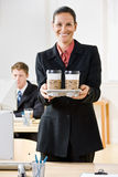 Businesswoman carrying tray of coffee. Businesswoman carrying a tray of coffee cups Royalty Free Stock Photo