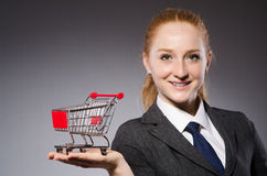 Businesswoman with cart Stock Images