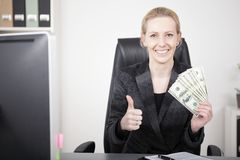 Businesswoman with Cash Showing Thumbs Up Stock Image