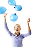 Businesswoman catching balloons Stock Photos
