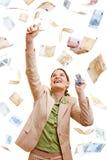 Businesswoman catching Euro Royalty Free Stock Photos
