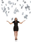 Businesswoman catching falling down dollars. Stock Photography