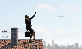 Businesswoman catching moment on her mobile Stock Photo