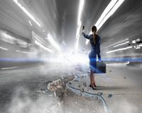 Businesswoman catching moment on her mobile . Mixed media Stock Photos