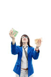 Businesswoman catching paper money  Royalty Free Stock Image