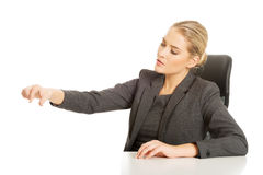 Businesswoman catching something at the desk Stock Photo