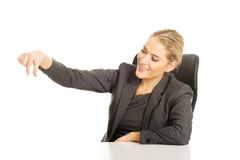Businesswoman catching something at the desk Royalty Free Stock Images