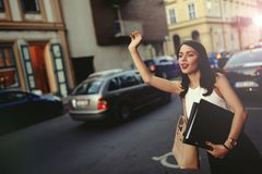 Businesswoman catching a taxi royalty free stock photography