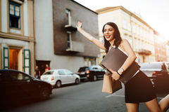 Businesswoman catching a taxi Royalty Free Stock Images