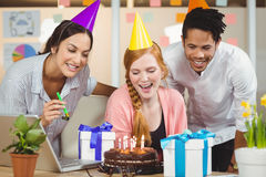 Businesswoman celebrating birthday with colleagues Stock Image