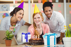 Businesswoman celebrating birthday with colleagues Royalty Free Stock Photo