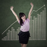 Businesswoman celebrating business growth Stock Image