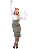 Businesswoman celebrating her success. Full length portrait of successful young businesswoman raising her arms in joy and smiling. Isolated on white background Royalty Free Stock Image