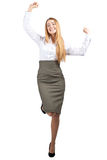 Businesswoman celebrating her success. Full length portrait of successful young businesswoman raising her arms in joy and dancing. Isolated on white background Royalty Free Stock Image