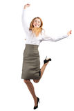 Businesswoman celebrating her success. Full length portrait of successful young businesswoman raising her arms in joy and dancing. Isolated on white background Royalty Free Stock Images