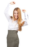 Businesswoman celebrating her success. Portrait of successful young businesswoman raising her arms in joy and smiling. Isolated on white background Stock Photos