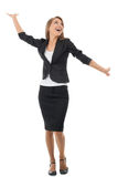 Businesswoman celebrating her success. Full length portrait of successful young businesswoman raising her arms in joy. Isolated on white background Royalty Free Stock Photos