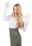 Businesswoman celebrating her success. Portrait of successful young businesswoman raising her arms in joy and smiling. Isolated on white background Stock Image