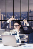 Businesswoman celebrating her success Stock Photos
