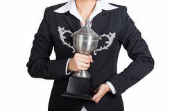 Businesswoman celebrating with holding trophy award for success Stock Photography