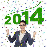 Businesswoman celebrating a new year 2014 Stock Images