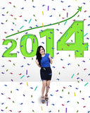 Businesswoman celebrating a new year. Happy successful business woman celebrating a new year 2014 Stock Image