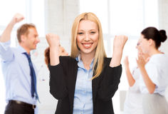 Businesswoman celebrating succes in office Royalty Free Stock Photos