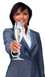 Businesswoman celebrating a success with Champagne Stock Image