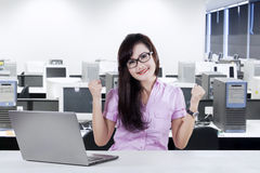 Businesswoman celebrating success in office Royalty Free Stock Photo