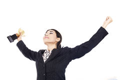 Businesswoman celebrating with trophy royalty free stock images