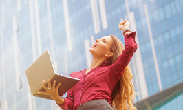 Businesswoman celebrating victory Stock Photography