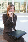 Businesswoman on cell outdoors Royalty Free Stock Photo