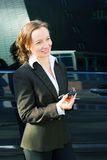 Business woman with a cell phone Royalty Free Stock Photo
