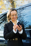 Businesswoman with a cell phone. Stock Image