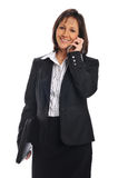 Businesswoman on the cell phone. Holding a portfolio isolated on white Stock Photos