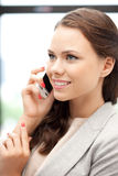 Businesswoman with cell phone Royalty Free Stock Photos