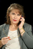 Businesswoman With Cell Phone Royalty Free Stock Photography