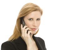 Businesswoman with cell phone. A businesswoman uses a cell phone Royalty Free Stock Image