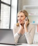 Businesswoman with cell phone stock photography